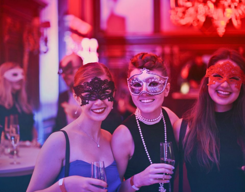 women in masquerade masks, event venue